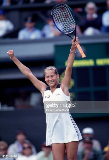 Anna Kournikova of Russia celebrates during the Wimbledon Lawn Tennis Championships at the All England Lawn Tennis and Croquet Club circa June 1997...