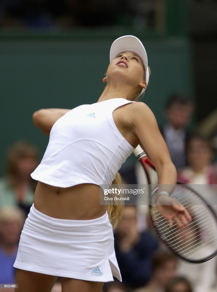 Anna Kournikova of Russia during her match against Venus and Serena Williams of the USA in the womens doubles semi final at the All England Tennis Championships at the All England Lawn Tennis Club, Wimbledon, England, on July 6, 2002.