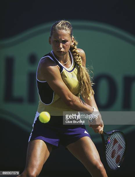 Anna Kournikova of Russia eyes the ball for a back hand return against Kristina Brandi during their Women's Singles second round match at the ATP...