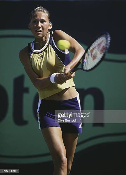 Anna Kournikova of Russia eyes the ball for a return against Kristina Brandi during their Women's Singles second round match at the ATP Lipton Tennis...