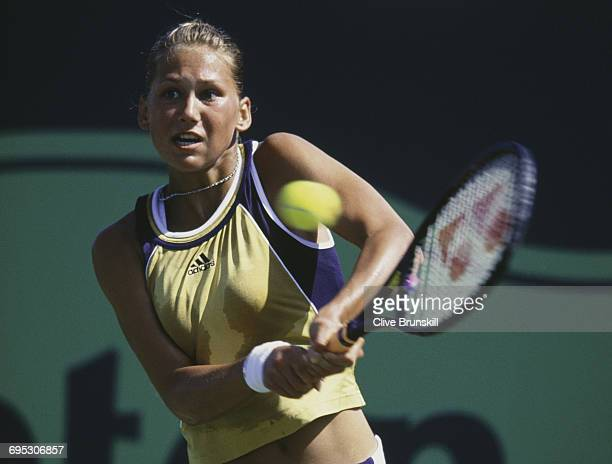 Anna Kournikova of Russia eyes the ball for a return against Kristina Brandi during their Women's Singles second round match at the ATP Lipton Tennis...