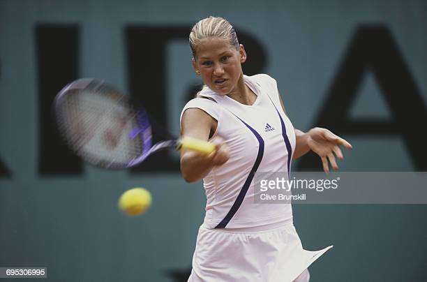 Anna Kournikova of Russia eyes the ball for a return against Sylvia Plischke during their Women's Singles second round match at the French Open...