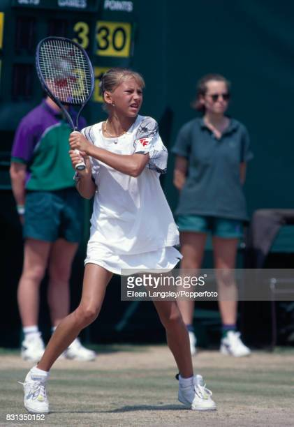 Anna Kournikova of Russia in action during a girls' singles match at the Wimbledon Lawn Tennis Championships in London circa June 1997