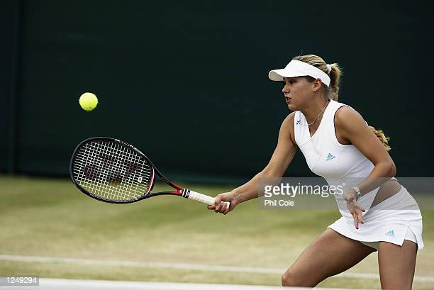 Anna Kournikova of Russia in action during the doubles match during the All England Tennis Championships at the All England Lawn Tennis Club...