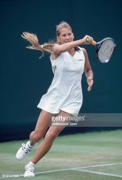 Anna Kournikova of Russia in action during the Wimbledon Lawn Tennis Championships at the All England Lawn Tennis and Croquet Club circa June 1997 in...