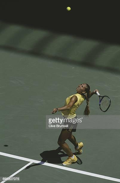 Anna Kournikova of Russia serves against Rita KutiKis during the Women's Singles second round match of the Australian Open tennis tournament on 18...