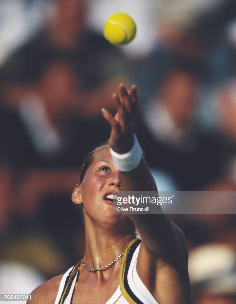 Anna Kournikova of Russia serves against Silvia Farina Elia during the Women's Singles first round match of the Sydney International tennis...