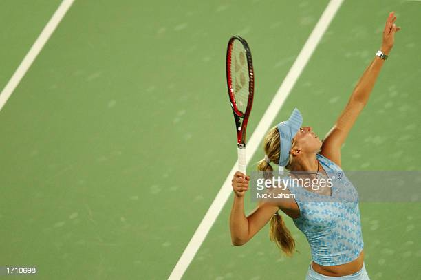 Anna Kournikova of Russia serves in her doubles match with partner Chandra Rubin of the USA in action during day two of the Adidas International...