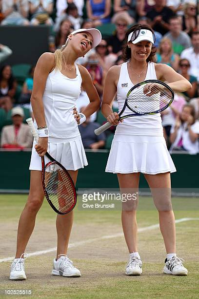 Anna Kournikova of Russia sticks out her tongue next to Martina Hingis of Switzerland during their Ladies Invitational doubles match against Anne...