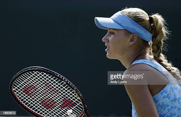 Anna Kournikova of Russia waits on the baseline during the doubles match Maria Sharapova at the Nasdaq100 Open March 24 2003 at the Tennis Center at...