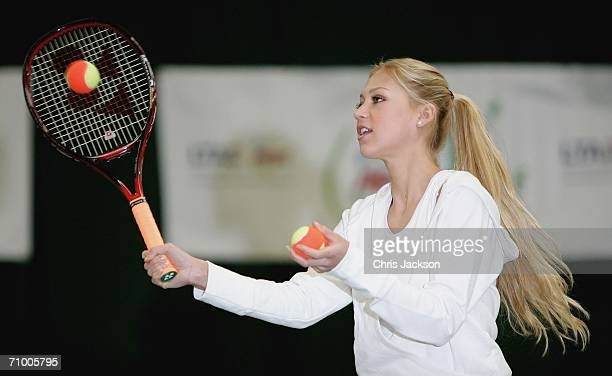 Anna Kournikova plays tennis at the Ariel Tennis ACE Finals Day on May 22 2006 in London England Anna Kournikova has teamed up with Tim Henman and...