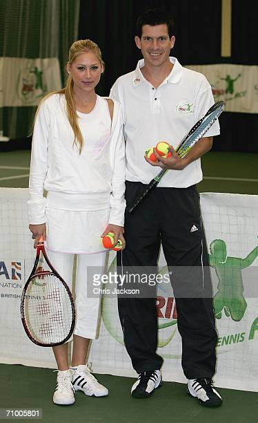 Anna Kournikova poses for a photograph with Tim Henman at the Ariel Tennis ACE Finals Day on May 22 2006 in London England Harry and Liza have made...