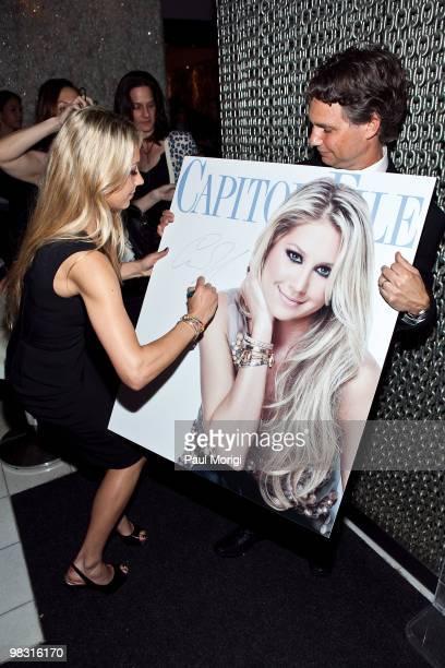 Anna Kournikova signs a poster of her magazine cover photo for Jason Binn CEO Niche Media/Capitol File Magazine at the Capitol File Magazine cover...