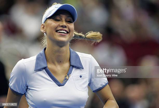 Anna Kournikova smiles after a point during the Serving for Tsunami Relief tennis match at Toyota Center in Houston Texas Tennis Champion's Jim...