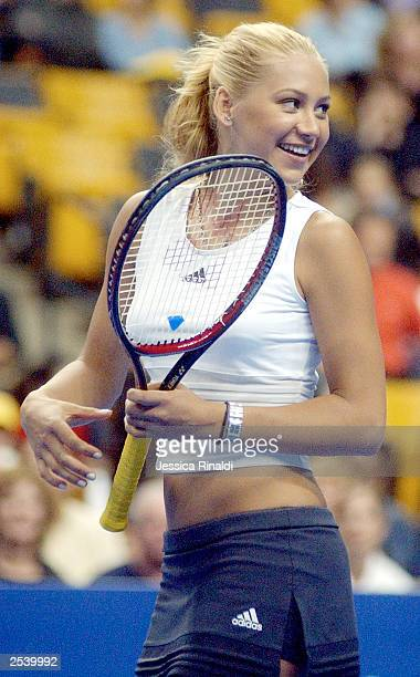 Anna Kournikova smiles at her doubles partner Andre Agassi during a doubles tennis match on September 25 2003 at the Fleet Center in Boston MA...