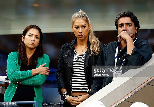 Anna Kournikova watches as Marin Cilic of Croatia plays against Kei Nishikori of Japan during the men's singles final match on Day fifteen of the...