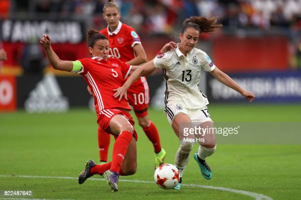 Anna Kozhnikova of Russia tackles Sara Dabritz of Germany during the Group B match between Russia and Germany during the UEFA Women's Euro 2017 at...