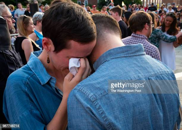 Anna Kramer is comforted by Karl Schrass during a vigil held in downtown Annapolis Maryland to honor the lives lost in yesterday's mass shooting...