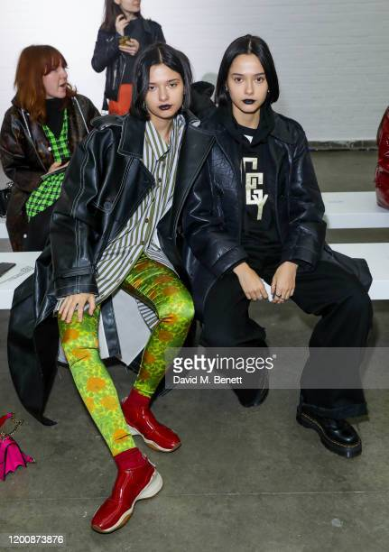 Anna Kuprienko and Sonia Kuprienko of the Bloom Twins attend the Marques'Almeida show during London Fashion Week February 2020 at The Old Truman...