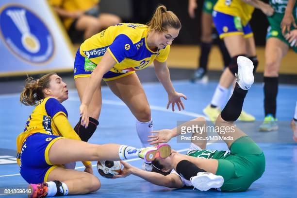 Anna Lagerquist and Sabina Jacobsen of Sweden and Aniko Kovacsics of Hungary in action during IHF Women's Handball World Championship group B match...