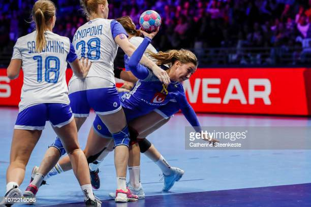 Anna Lagerquist of Sweden is shooting the ball against Irina Snopova of Russia during the EHF Women's Euro main stage match between Sweden and Russia...