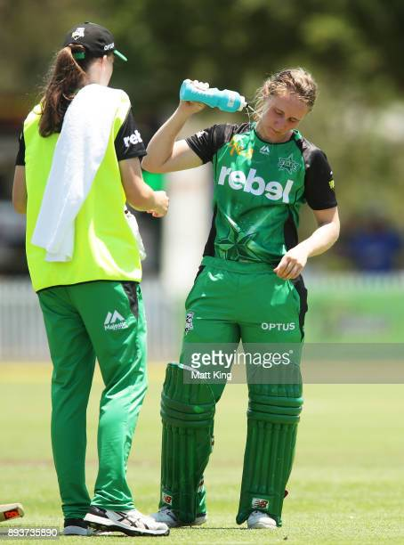 Anna Lanning of the Stars attempts to cool down during the Women's Big Bash League match between the Melbourne Stars and the Sydney Thunder at...