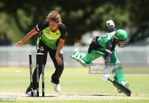 Anna Lanning of the Stars slides in to avoid a runout as Belinda Vakarewa of the Thunder fields during the Women's Big Bash League match between the...