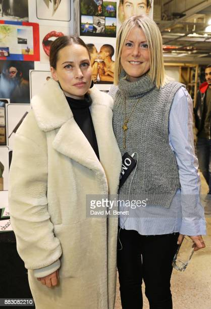 Anna Laub and Olivia McCall attend the Dover Street Market Holiday Open House on November 30 2017 in London England