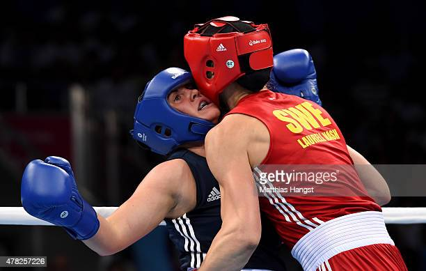 Anna Laurell Nash of Sweden and Lidia Fidura of Poland compete in the Women's Boxing Middleweight Semi Final during day twelve of the Baku 2015...