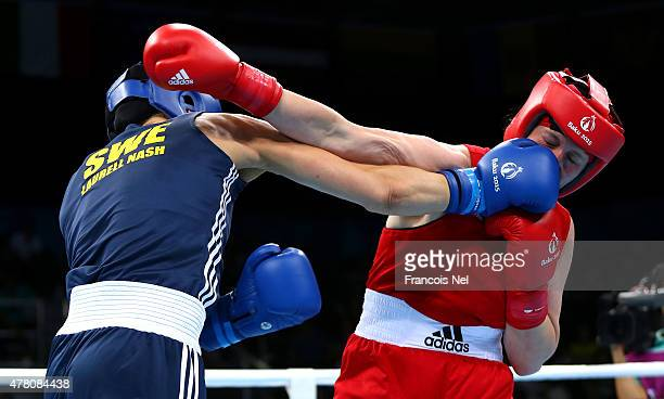 Anna Laurell Nash of Sweden and Victoriya Kebikava of Belarus compete in the Women's Middleweight Quarter Final during day ten of the Baku 2015...