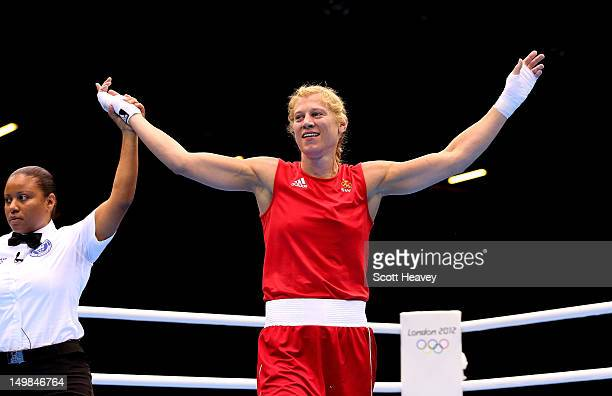 Anna Laurell of Sweden celebrates her vicotry over NaomiLee FischerRasmussen of Australia during the Women's Middle Boxing on Day 9 of the London...