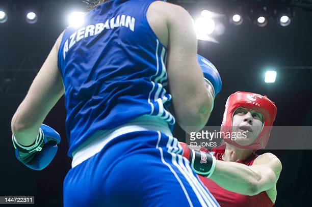 Anna Laurell of Sweden clashes with Elena Vystropova of Azerbaijan during their middleweight semifinal bout at the Women's World Boxing Championships...