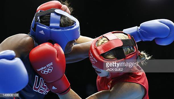 Anna Laurell of Sweden defends against Claressa Shields of the USA during the women's Middleweight boxing quarterfinals of the 2012 London Olympic...