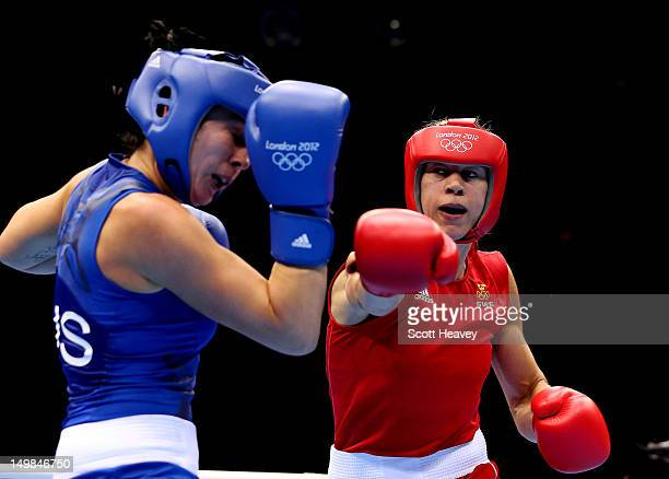 Anna Laurell of Sweden in action with NaomiLee FischerRasmussen of Australia during the Women's Middle Boxing on Day 9 of the London 2012 Olympic...