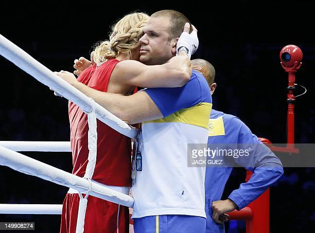 Anna Laurell of Sweden is consoled following her points loss to Claressa Shields of the USA in the women's Middleweight boxing quarterfinals of the...