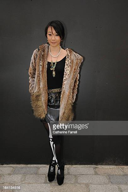 Anna Lei Fashion blogger for collegefashionistacom wearing vintage fur jacket with Zara top Zara skirt accessorised with Fossil pendant mettalic bead...