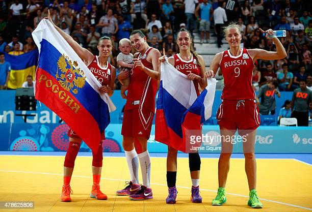 Anna Leshkovtseva Tatiana Vidmer Tatiana Petrushina and Mariia Cherepanova of Russia celebrate winning gold during the Women's 3x3 Basketball gold...