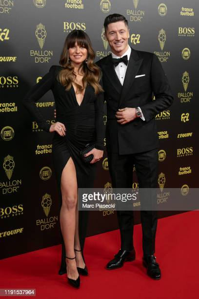 Anna Lewandowska and Robert Lewandowski attend the photocall during the Ballon D'Or Ceremony at Theatre Du Chatelet on December 02 2019 in Paris...
