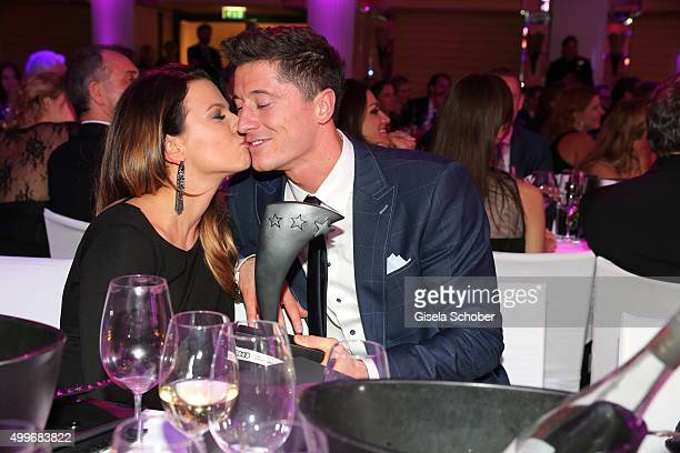 Anna Lewandowski and Robert Lewandowski with award during the Audi Generation Award 2015 at Hotel Bayerischer Hof on December 2, 2015 in Munich,...