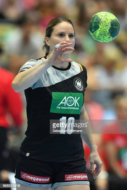 Anna Loerper of Germany catches the ball during the Women's handball International friendly match between Germany and Poland at Olympiahalle on June...