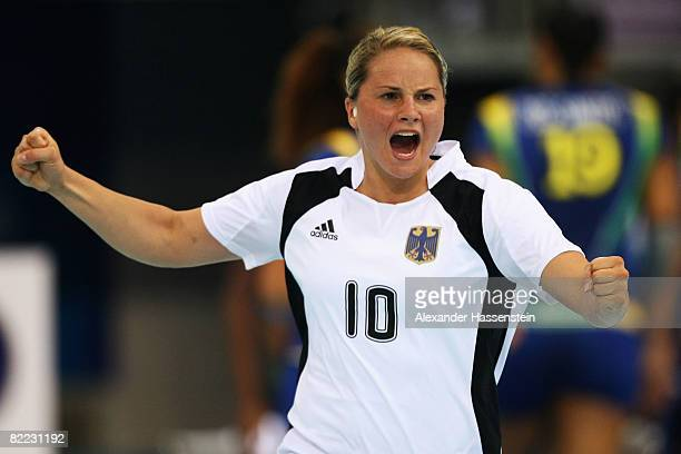 Anna Loerper of Germany celebrates a goal during the handball match between Germany and Brazil held at the Olympic Sports Center Gymnasium during day...