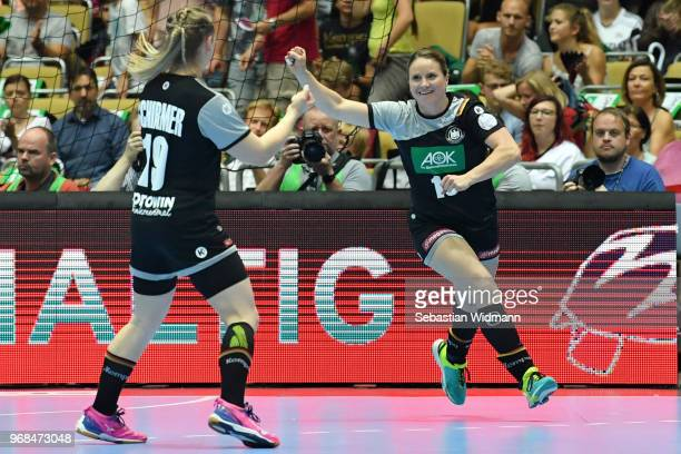 Anna Loerper of Germany celebrates scoring a goal during the Women's handball International friendly match between Germany and Poland at Olympiahalle...