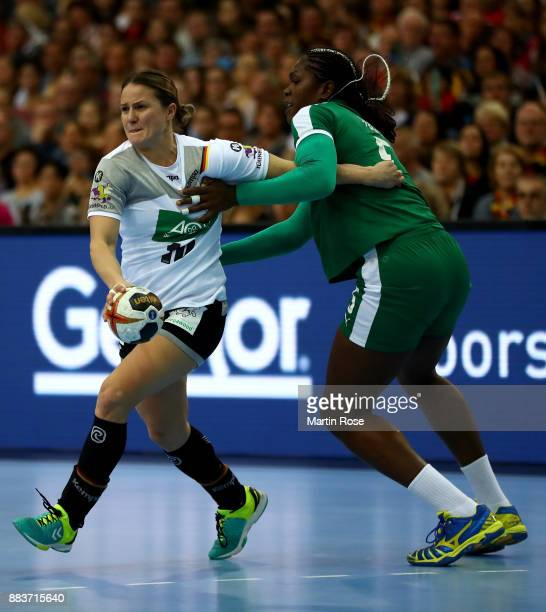 Anna Loerper of Germany challenges Anne Michelle Essam of Cameroon during the IHF Women's Handball World Championship group D match between Germany...
