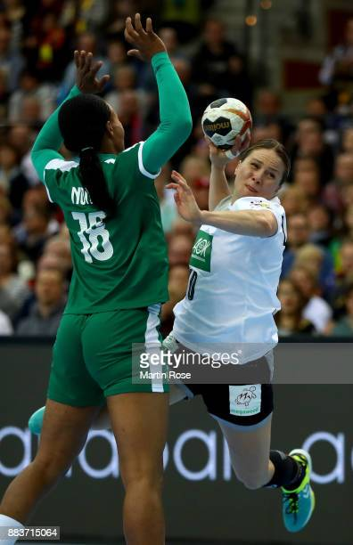 Anna Loerper of Germany challenges Aubiege Njampou Nono of Cameroon during the IHF Women's Handball World Championship group D match between Germany...