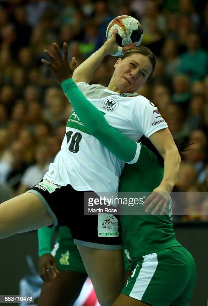 Anna Loerper of Germany challenges of Yvette Yuoh of Cameroon during the IHF Women's Handball World Championship group D match between Germany and...