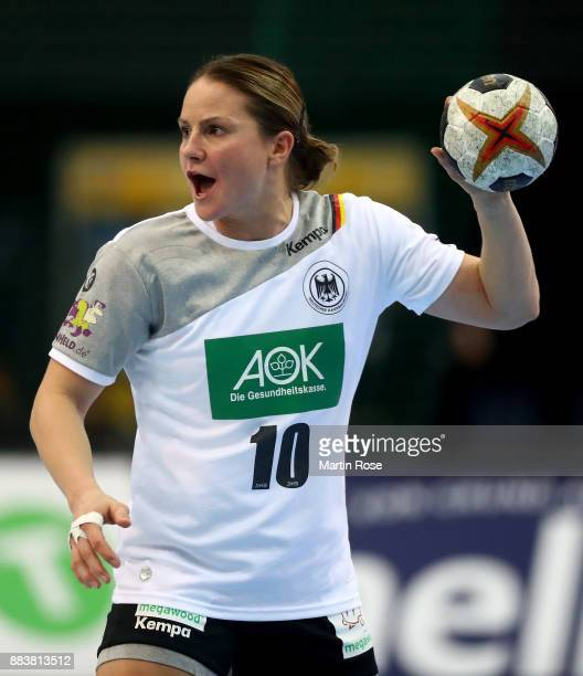 Anna Loerper of Germany controls the ball during the IHF Women's Handball World Championship group D match between Germany and Cameroon at Arena...