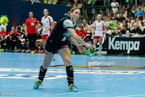 Anna Loerper of Germany controls the ball during the Women's handball International friendly match between Germany and Poland at Olympiahalle on June...