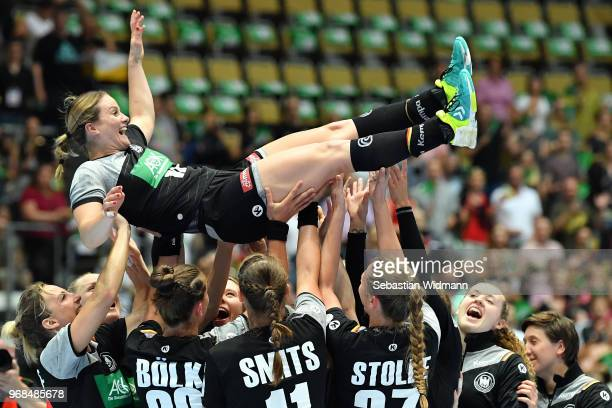 Anna Loerper of Germany is being thrown in the air by teammates after the Women's handball International friendly match between Germany and Poland at...