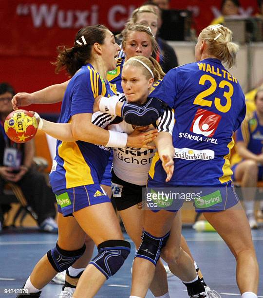 Anna Loerper of Germany is blocked by Sweden's Therese Wallter during the preliminary round match between Germany and Sweden at Wuxi Stadium on day...
