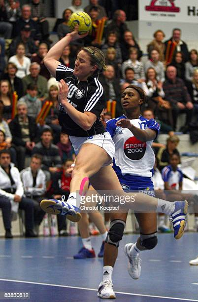 Anna Loerper of Germany scores a goal against Siraba Dembele of France during the International Handball Friendly match between Germany and France at...